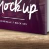 موکاپ کتاب با جلد سخت و آیفون 6 روی میز چوبی 3